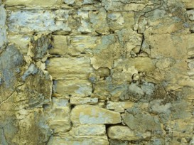 an-old-stone-wall-with-crumbling-plaster1
